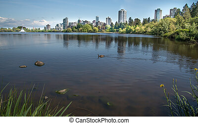 Stanley Park lake with skyline