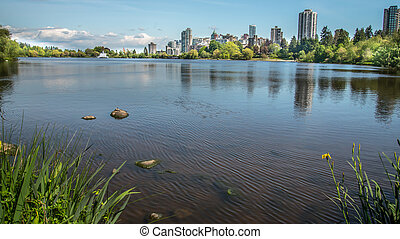 Stanley Park lake with skyline - Landscape of Stanley Park...