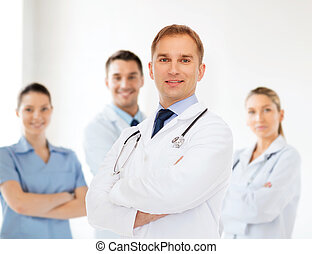 smiling male doctor with stethoscope - healthcare,...