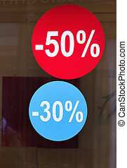 sale in shop - signs with 50 percent in a window of a shop....