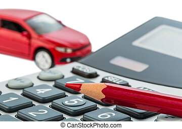 auto, red pen and calculator - a car and a red pen lying on...
