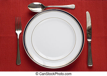 plate, fork, knife and spoon - fork, knife and spoon in a...