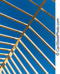 a new roof truss - in a house with a new roof is built on a...