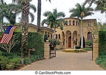 Large Home - A very large home with pillars and a flag.