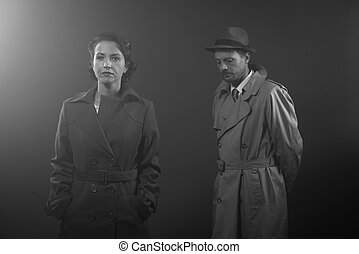 Film noir scene with elegant man and woman standing in the...