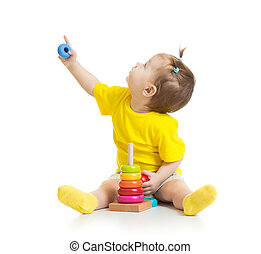 baby playing with colorful toy and looking up isolated on...