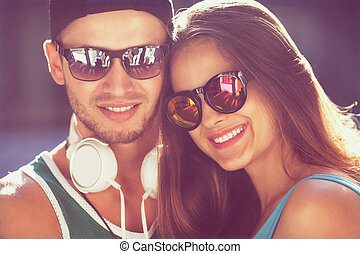 Close up portrait of happy smiling hipster couple in love...