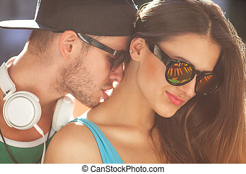 Close up portrait of happy smiling hipster couple in love....