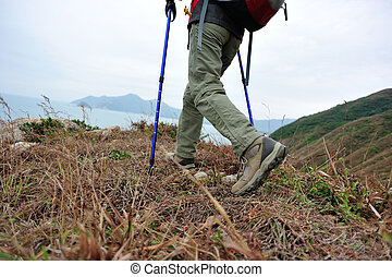 woman hiker hiking on seaside trail