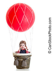 child boy on hot air balloon isolated on white background