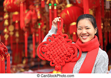 young woman with red chinese knot - young asian woman with...