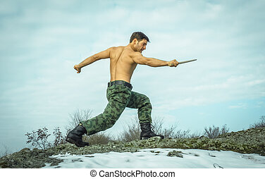Military man training martial arts
