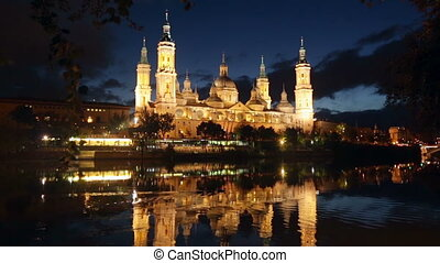 Cathedral in night. Zaragoza - Cathedral and Ebro river in...