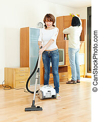 Happy couple doing housework together in home