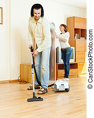 couple are doing house cleaning - middle-aged couple are...
