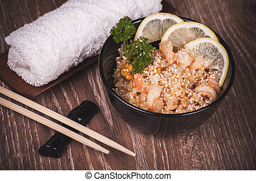 seafood fried rice in bowl with chopsticks