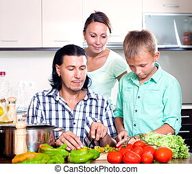 Happy family cooking veggy lunch - Happy family with...