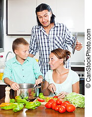 Cutting the vegetables for salad - Happy couple with...