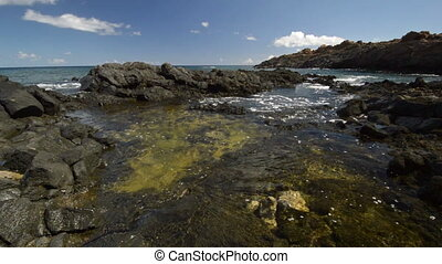 Volcanic shore of Lanzarote, Canary Islands, Flowing water...