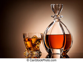 Golden whiskey - Decanter and glass of golden whiskey on...