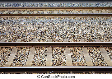 Two parallel railway tracks side by side