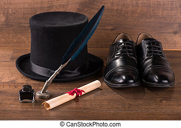 black patent leather shoes on floor - black classic hat near...