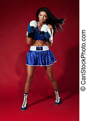 Attractive woman fighting - Beautiful woman boxer posing on...
