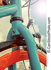 Vintage look at one bicycle in lens flare reflection -...