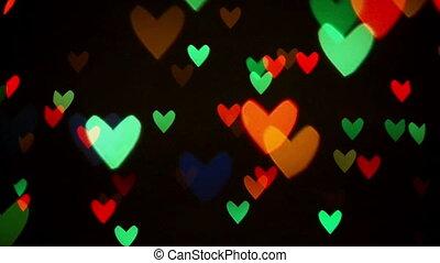 Blinking hearts - Colorful defocused blinking heart bokeh...