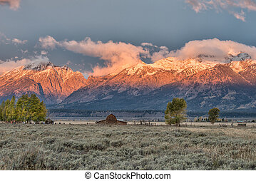 Sunrise at Mormon Row in Grand Teton National Park during...