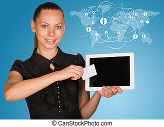 Beautiful businesswoman holding tablet PC Network with...