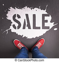Sale inscription - Sale concept with red sneakers and white...