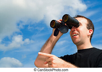 Bird Watching - A man bird watching with a set of binoculars...