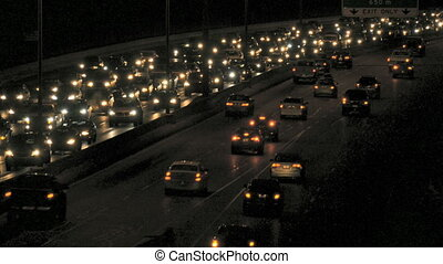 Night Commuter Traffic - Head and tail lights of night time...