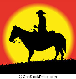 silhouette of cowboy on horse in the sunset