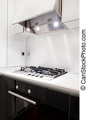 Detail of the black kitchen with the open hood