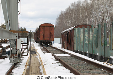the prospect of old rail cars on a railway track stock