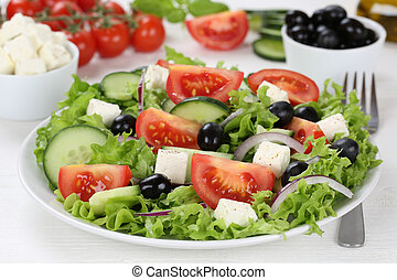 Greek salad on table in bowl with tomatoes, Feta cheese and...