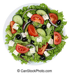 Greek salad with tomatoes, Feta cheese and olives in bowl from a