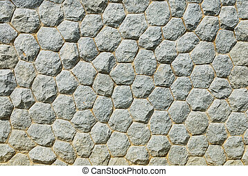 Gray rough stone wall with cement