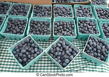 blue berries - pint boxes of blueberries for sale at a local...
