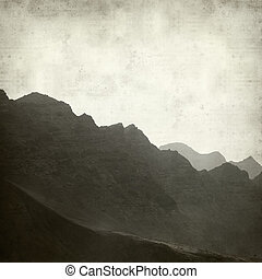 textured old paper background with steep mountains of North...