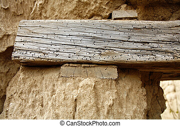 Lintel with woodworm in an abandoned adobe house - Near...