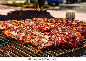 large rack of ribs on barbecue