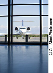Private Corporate Jet at An AIrport Terminal - A small twin...