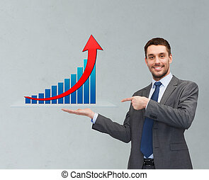 happy man showing growth chart on palm of his hand -...