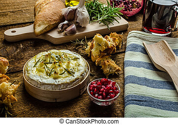 Baked Camembert with Garlic & Rosemary, with toast baked on...