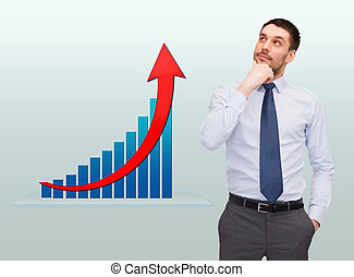 thinking young businessman with growth chart - business,...