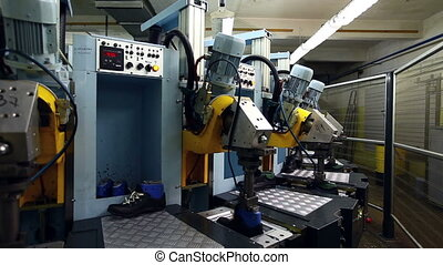 Machine at factory of footwear manufacture