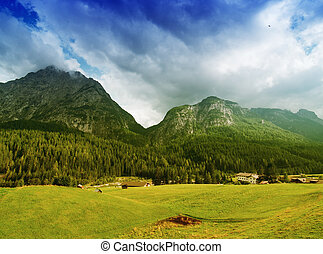 Beautiful Dolimites landscape. Meadows, mountains and sky.